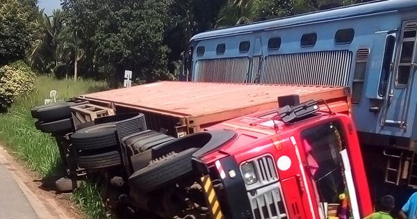 Container Truck Flipped Near Railway Line